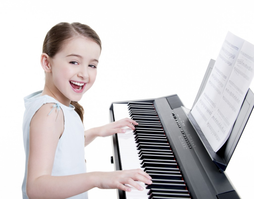 Girl playing the keyboard
